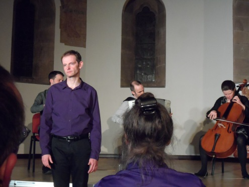 Photo shows storyteller, Daniel Morden, and the musicians from The Devil's Violin Company
