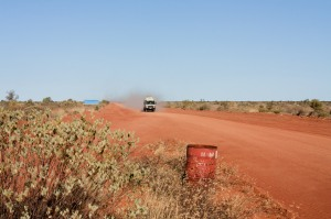 Tour bus drives through Australian outback