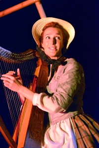 Cast member playing the harp