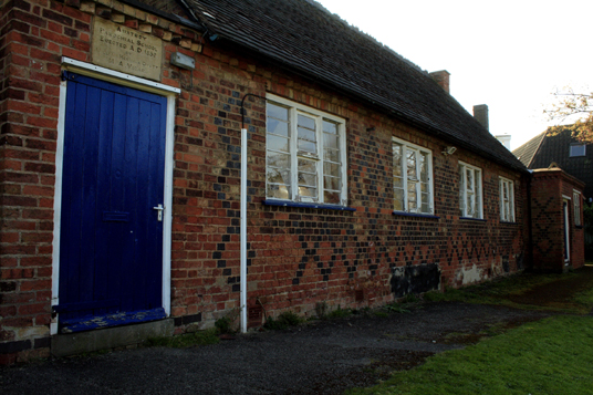 Austerey Village Hall. A one story brick building.