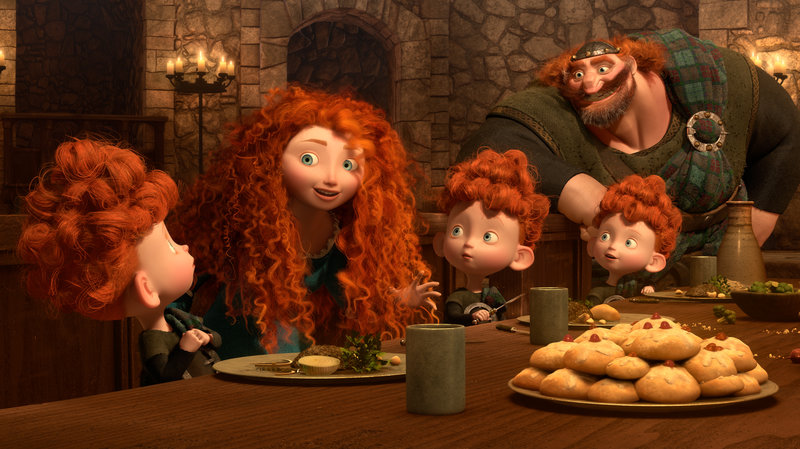 Merida telling a story to the triplets and the king. They all have curly red hair and are wearing green as they sit at a table with iced buns on it.