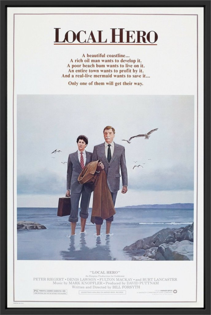 Local Hero poster with an illustration of two men in suits on a beach. Text: A beautiful coastline...A rich oil man wants to develop it. A poor beach bum wants to live on it. An entire town wants to profit by it. And a real-live mermaid wants to save it... Only one of them will get their way.