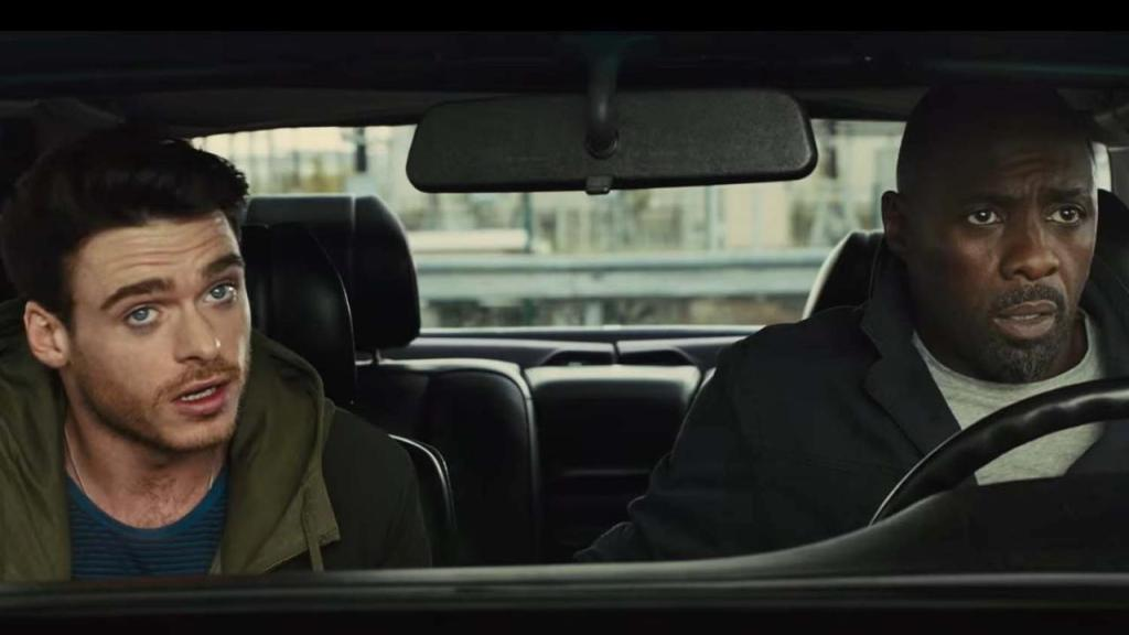 Richard Madden & Idris Elba in a car.